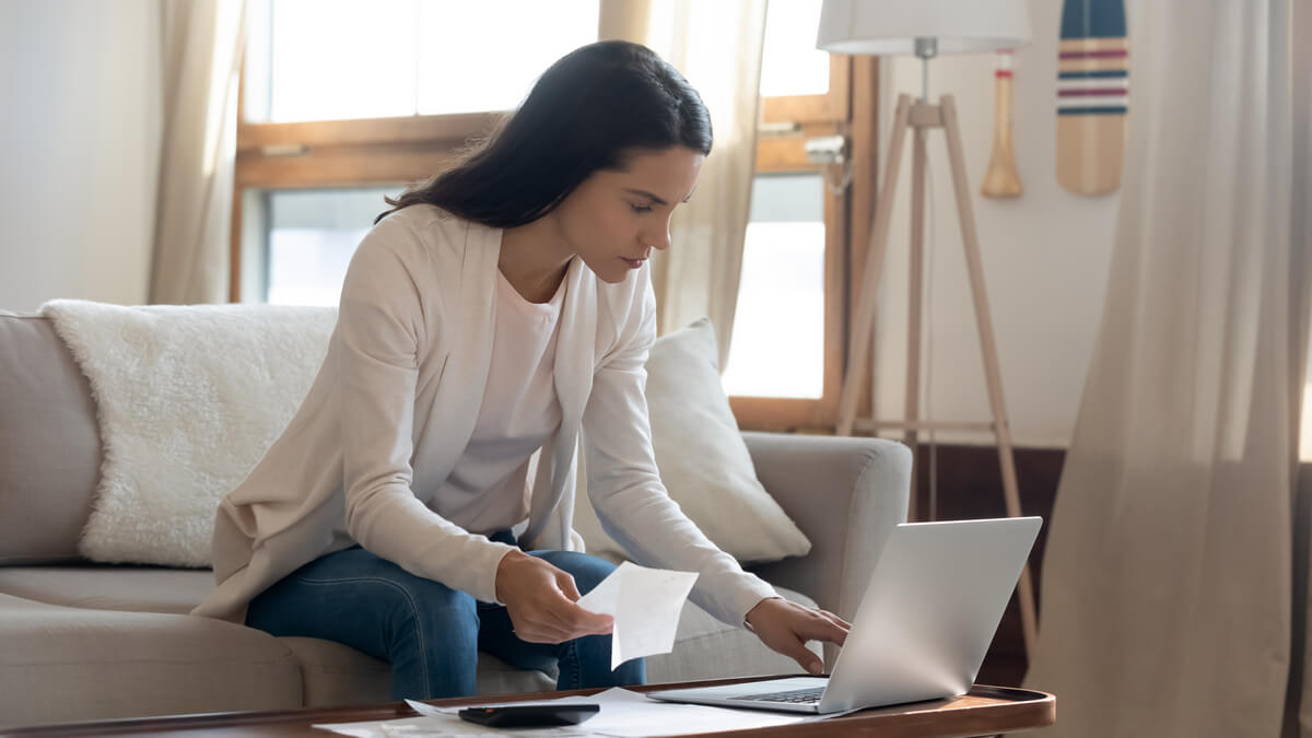 Home buyer evaluating choices on computer